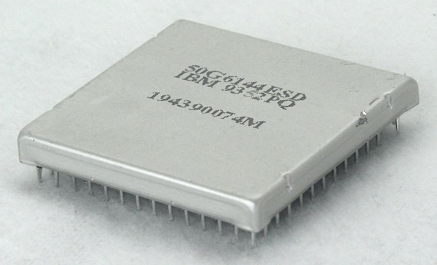 "The integrated circuit is packaged in a square aluminum can, 1.5"" on a side."