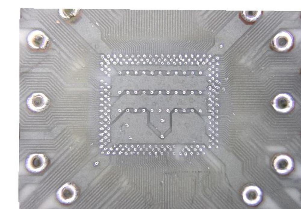 A closeup of the ceramic substrate showing where the die is mounted.