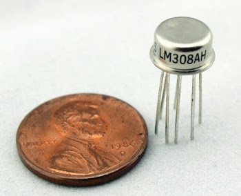 The LM308 op amp in an 8-pin metal can.