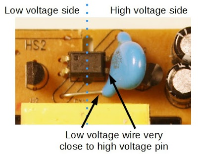 Safety hazard inside an imitation Macbook charger. The lead of the Y capacitor is too close to the pin of the optoisolator, causing a risk of shock.