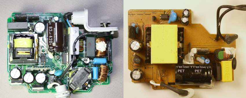 Inside the Apple 85W Macbook charger (left) vs an imitation charger (right). The genuine charger is crammed full of components, while the imitation has fewer parts.