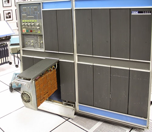 The IBM 1401 computer with gate 01B3 open, showing the timing and logic circuitry.