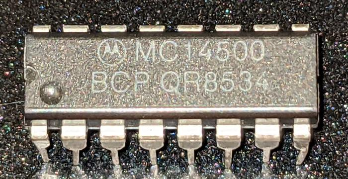 "The MC14500B comes in a 16-pin DIP integrated circuit, much smaller than the 40-pin packages commonly used for microprocessors at the time. The ""CP"" suffix indicates a plastic package. Photo from siliconpr0n (CC BY 4.0)."