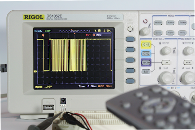 Analyzing the IR signal from a TV remote using an IR sensor and a Rigol DS1052E oscilloscope.