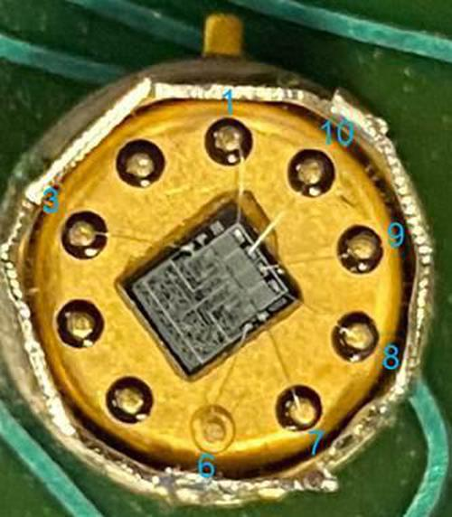 The metal can of the CG2341 with the lid removed, showing the silicon die inside.