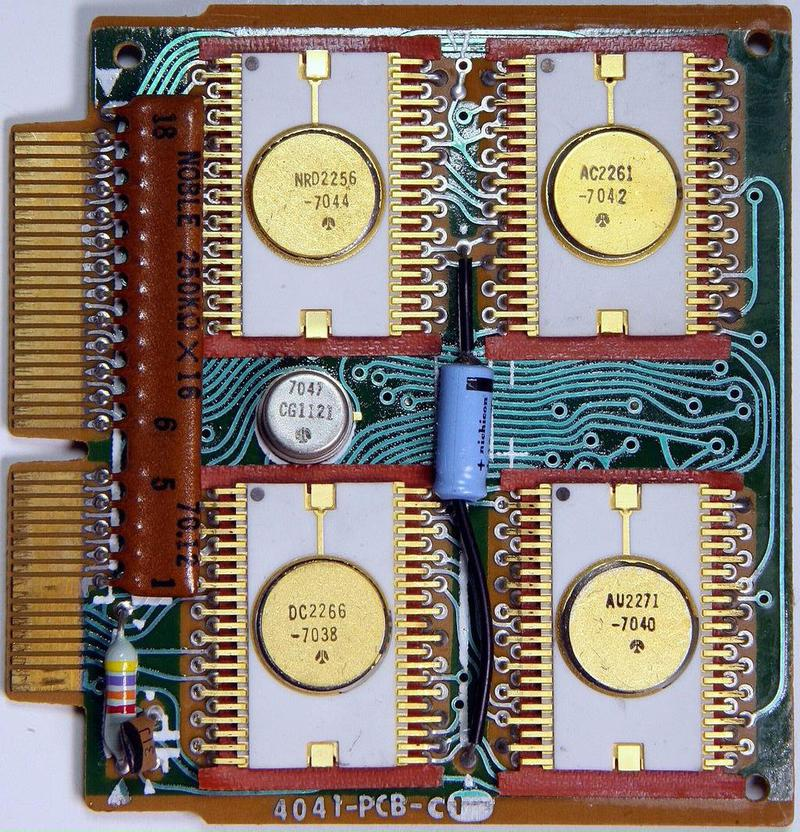 The circuit board for the Sharp EL-8 calculator. The clock IC is the small metal-can package in the middle. Photo from Mister rf (CC BY-SA 4.0).