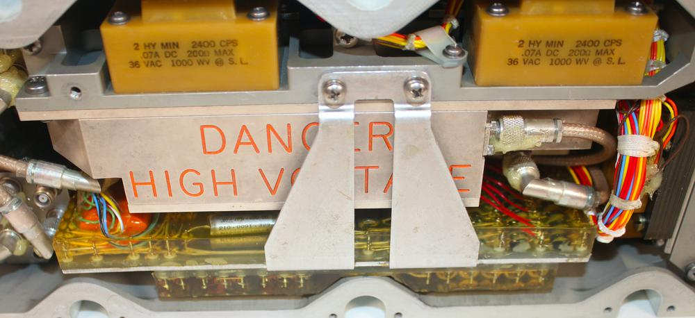 The amplifier uses high-voltage transformers to power the traveling-wave tubes.