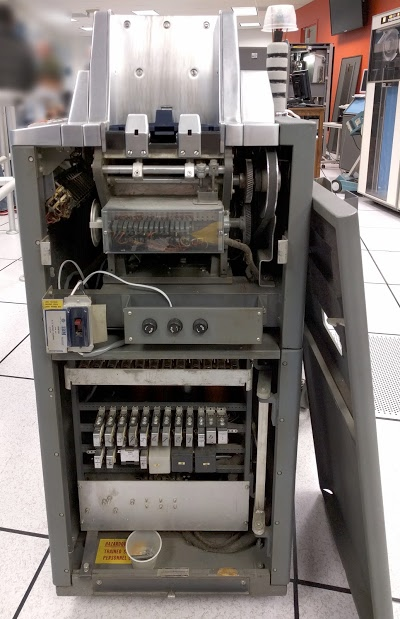 Inside the IBM type 83 card sorter. At top is the card feed. The cams are behind clear plastic.