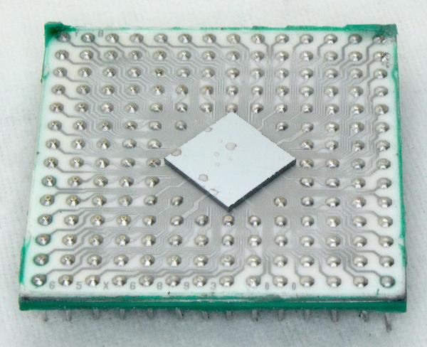 The die is mounted upside down on the ceramic substrate.