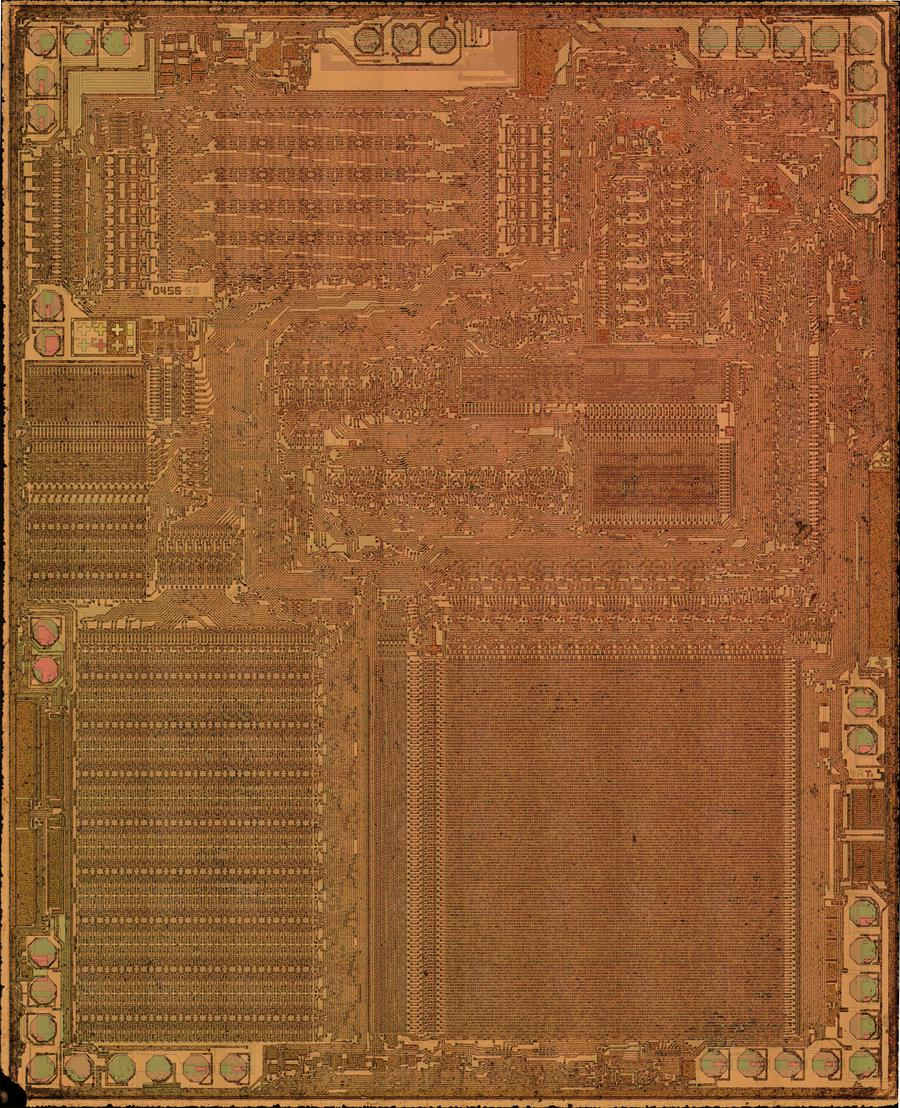 Die photo of a TP0456 as used in the TI-55-II calculator; the calculator uses two TP0456 chips. Die photo courtesy of Sean Riddle.