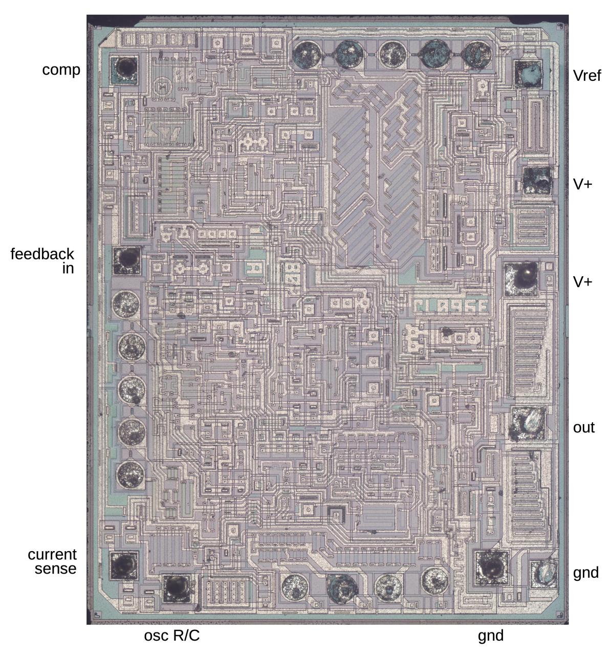 The UC3842 die. Around the outside, the pins are labeled. (Click this image, or any other, for a larger version.)