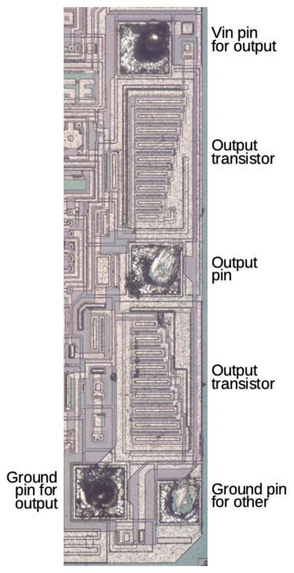 Two large transistors drive the output pin.